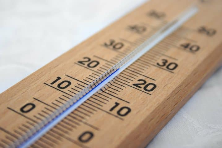 Wooden thermometer with mercury rising up