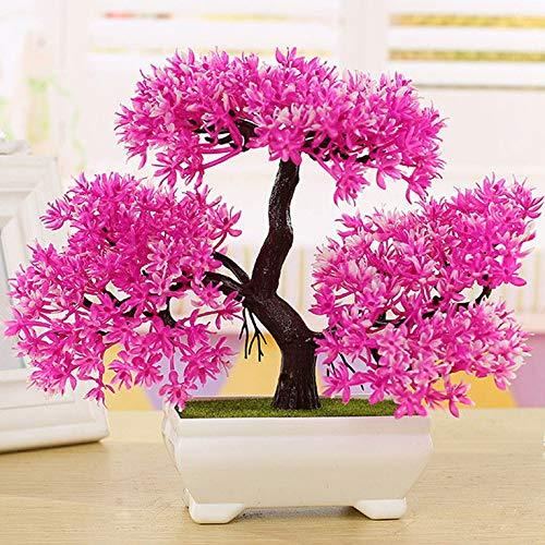 Bright pink flower bonsai on a ceramic pot.