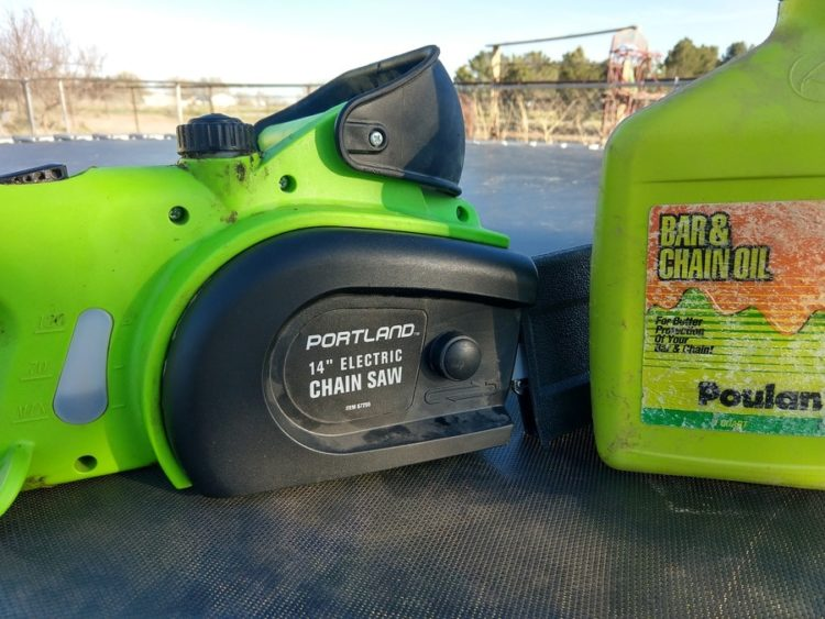 "Green 14"" Portland Chainsaw and a gallon of bar and chain oil."