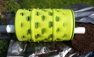 Painted barrel with installed compost tube.