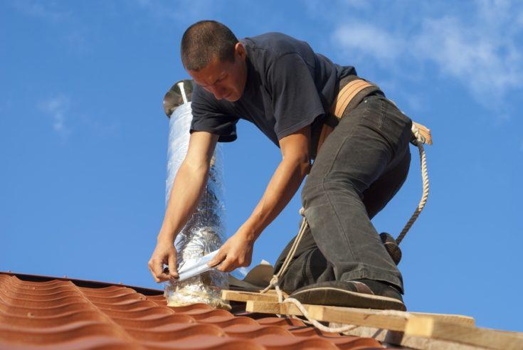 a man installing ventilation system