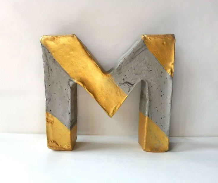 concrete letter with gold paint design