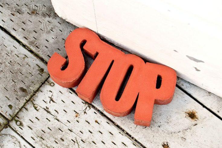 orange concrete door stop