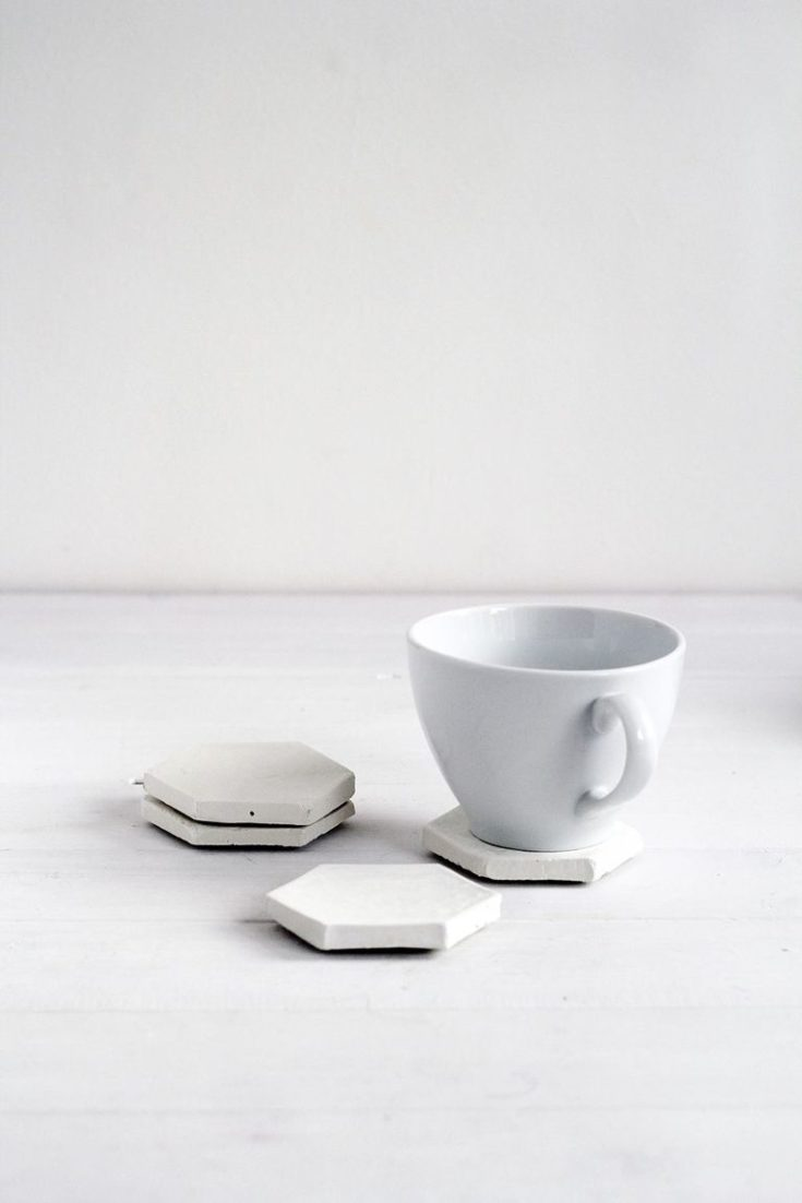 white cup and four Hexagon Concrete Coasters