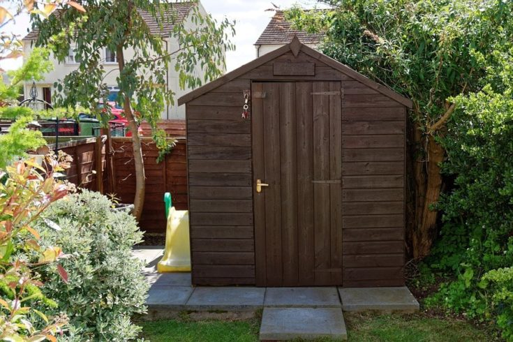 A simple wooden cabin design garden shed