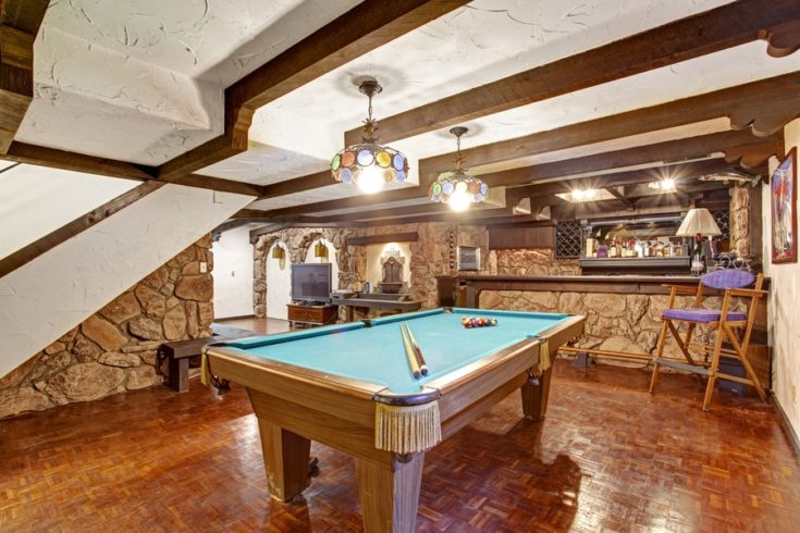 Entertainment room with pool table. Castle theme design