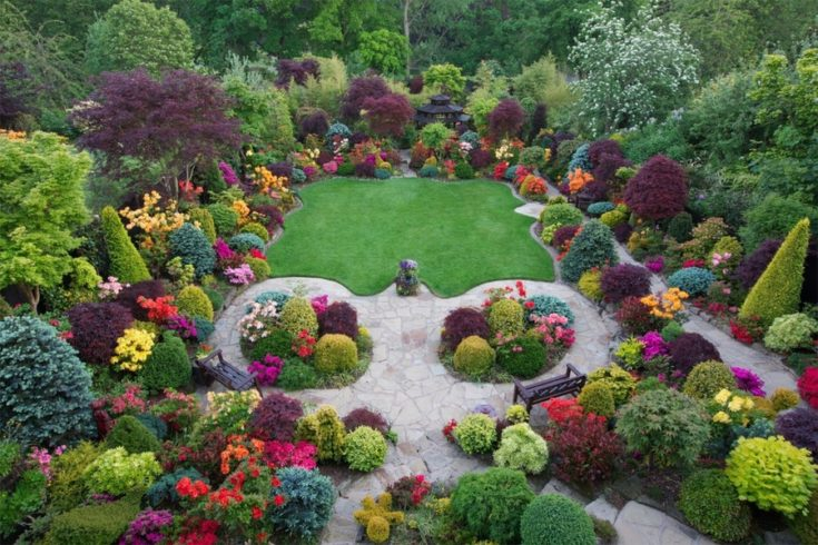 a garden that has an outstanding landscape and colorful flowers