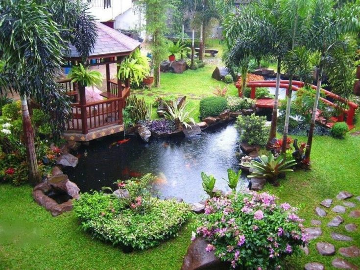 garden landscape with fish pond, bridge and waiting shed
