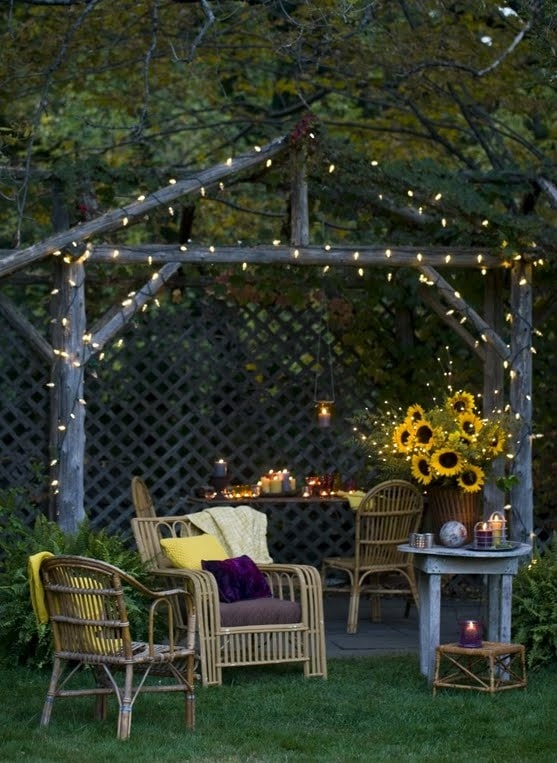 soft lighting setup with candles and light bulbs on the garden
