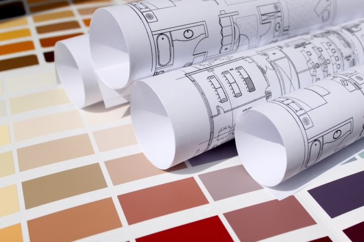New home design,architecture,interior design concept - blueprints for a new home and background of a paint color palette to be chosen for home