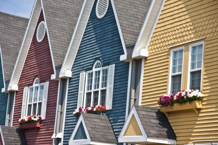A row of colorful holiday houses by the seaside.