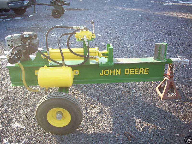 Hydraulic tank log splitter in yellow and green color combination