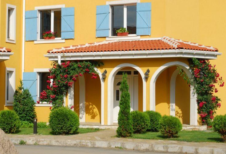 Orange country house back door, blue shutters