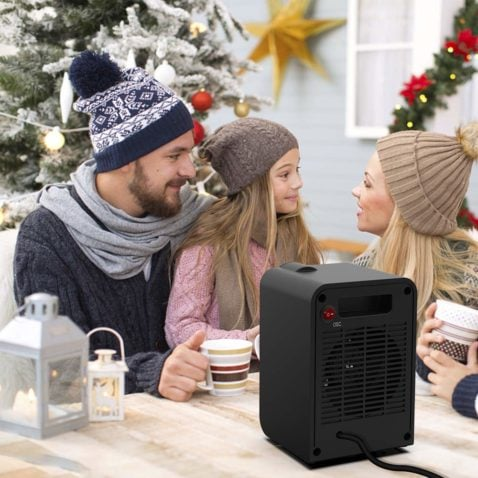 a family with a portable space heater in a table