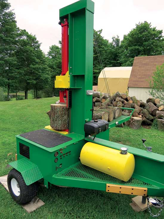 homemade log splitter loading arm in the backyard