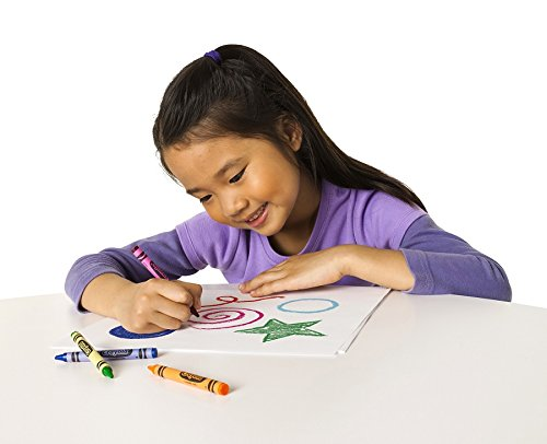 Little girl using Crayola Crayons 24 Colors isolated in white background