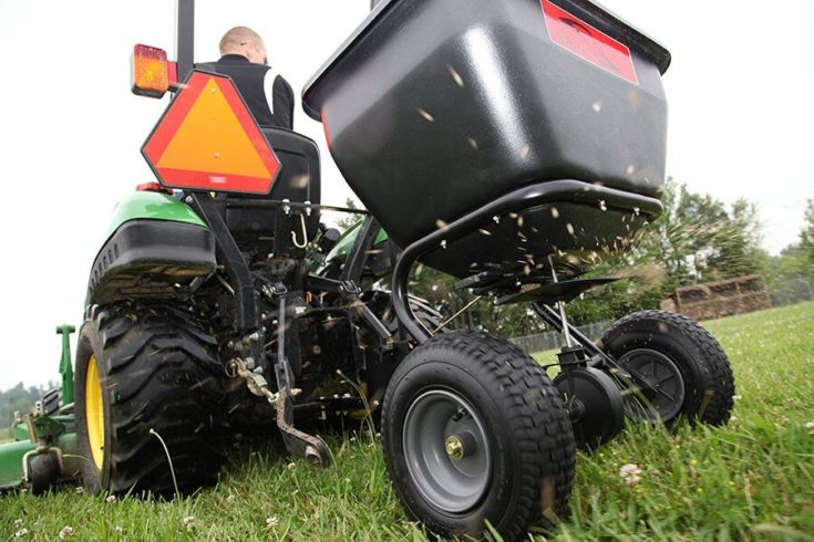 A Tow Behind Broadcast Spreader in action