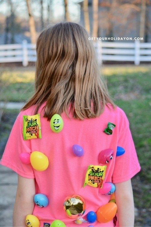 easter egg tag game, a little girl showing her back with easter eggs sticking on it