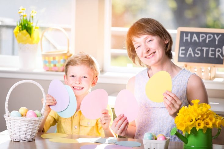 family of two, mother and her son, celebrating easter time at home with fun activities and easter egg hunt