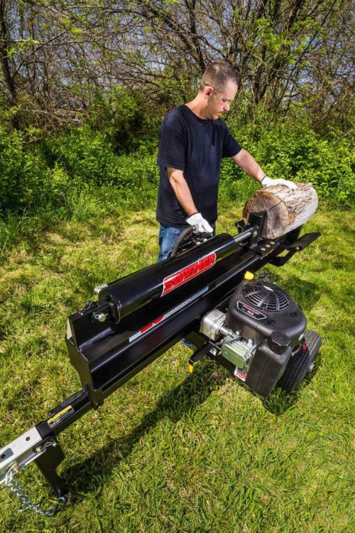 A man using Swisher Log Splitter in the backyard