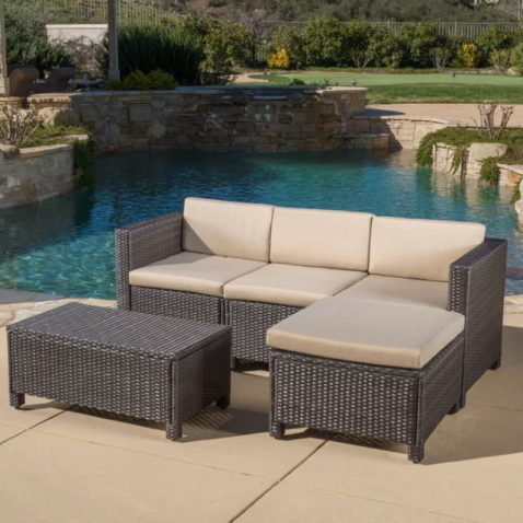 Furst 5 Piece Sectional Seating Group with Cushions in the pool area