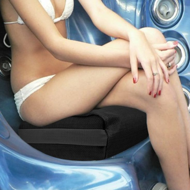 A woman setting on a Submersible Spa Water Seat