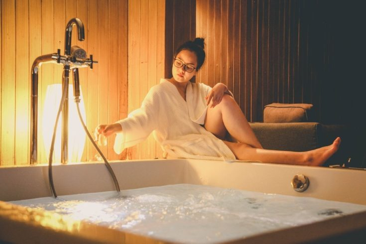 Woman preparing hot tub