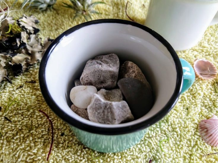 Small rocks put inside a cup.