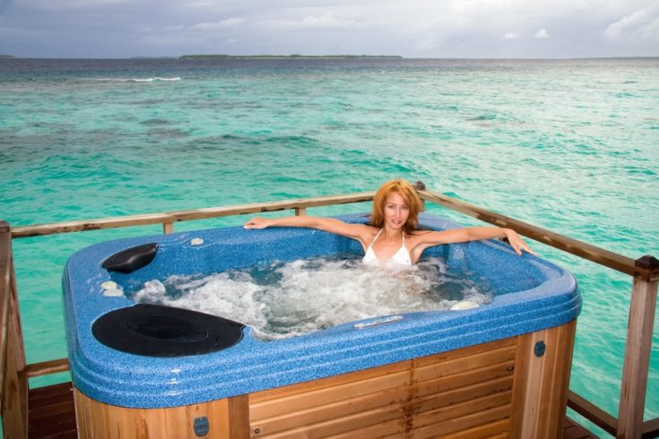 Woman in jacuzzi on background of ocean