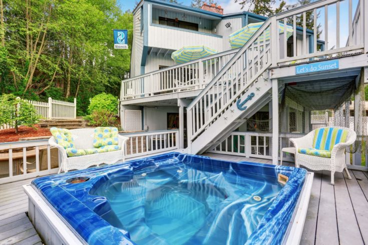 Large marine style home with two level deck with Jacuzzi on first floor