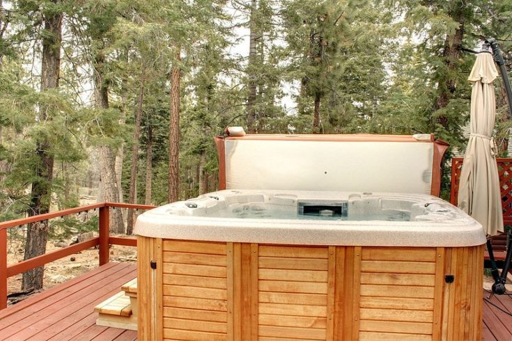 Relaxing Hot Tub Deck Surrounded by Trees