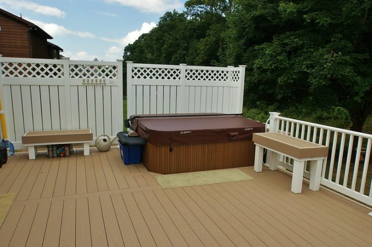 close-up view of the hot tub area of the deck. Two custom benches were also built to meet the customers needs