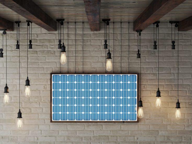 Solar energy frame on brick wall makes electric energy.