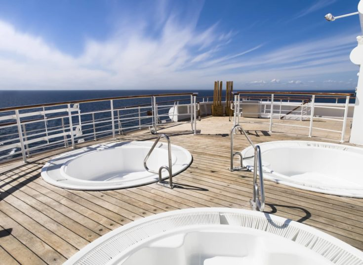 Three hot tub on the deck of a cruise in a sunny day