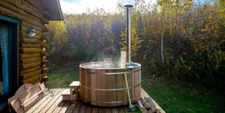 wooden hot tub on the backyard