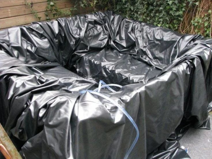 DIY Hot Tub Jacuzzi in gray cover with hose