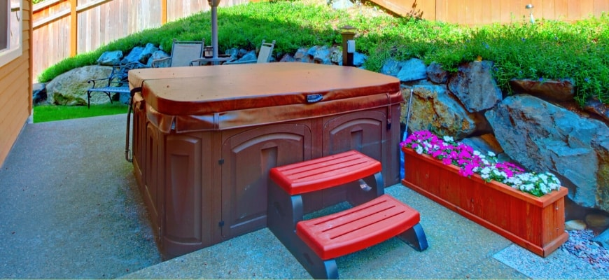 All You Need to Know About Hot Tub Weight - a brown hot tub setup outdoor