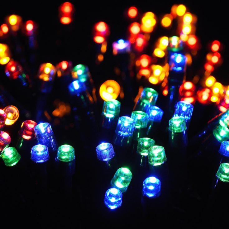 Colorful solar lights in black background.