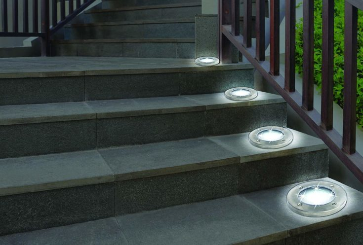 Bell + Howell Solar Disk Light put on the side of the steps to light stairs.