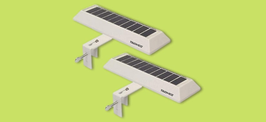 Two gutter/fence solar lights in a light green background.