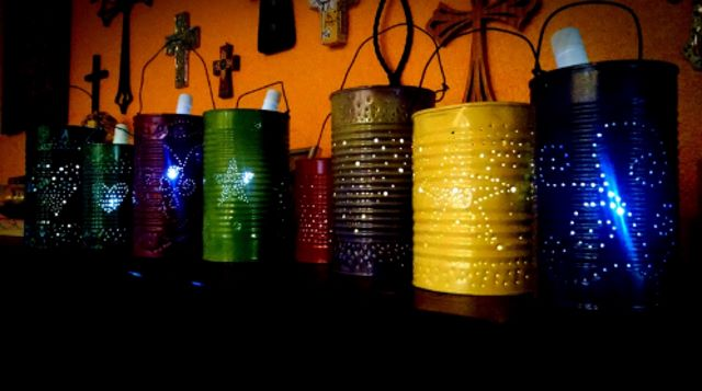 Colorful tin cans with designs and solar lights inside to produce lights.