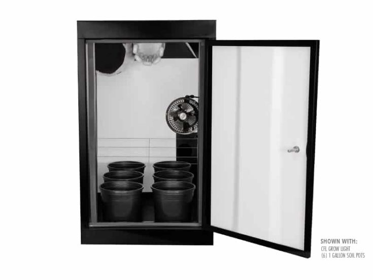 Grow cabinet with plastic pots inside.