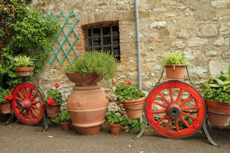 fancy country backyard with many planters with flowers , Tuscany,Italy, Europe