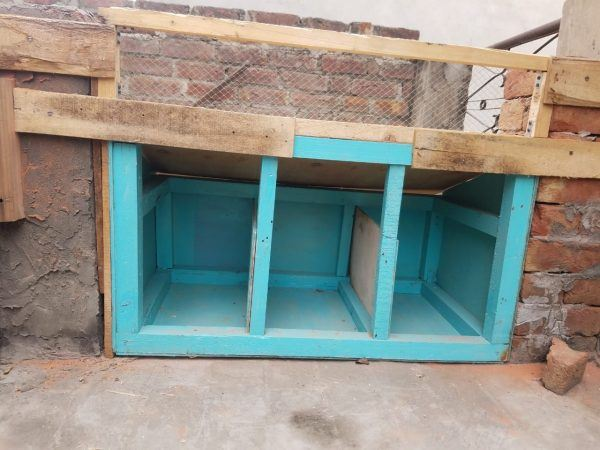 Simple Nesting Box made of wood with blue paint