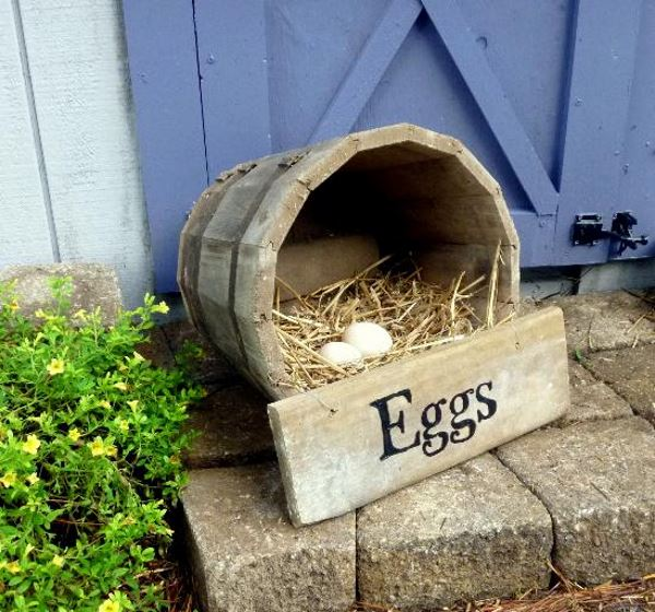 Wooden Half Barrel Nesting Box with hays and eggs inside