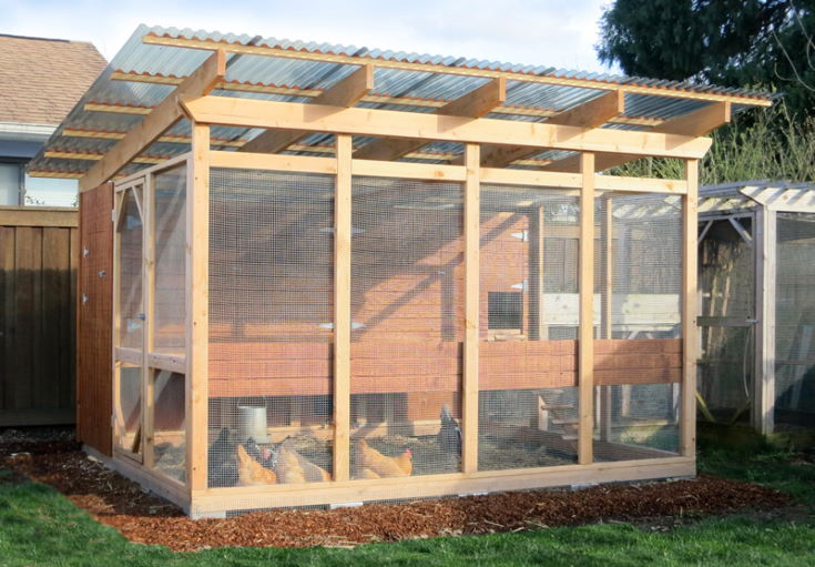 large wooden chicken coop with chicken inside