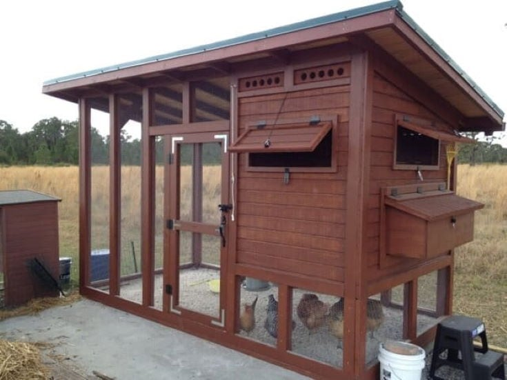 wooden chicken coop with brown paint