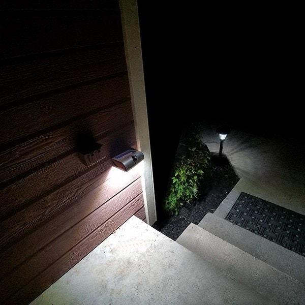 Solar Wall Light attach on a wall near a staircase