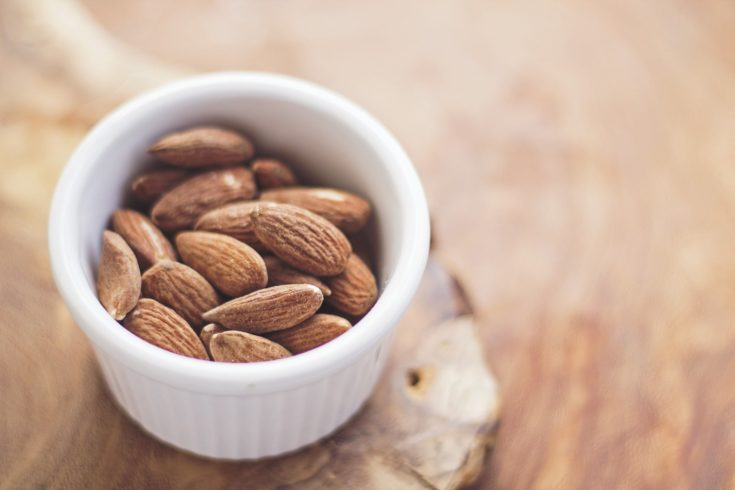 A cup of roasted almonds.