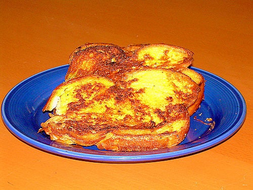 French toast bread on a ceramic blue plate.